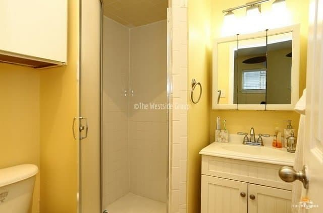 standing shower with updated bathroom fixtures