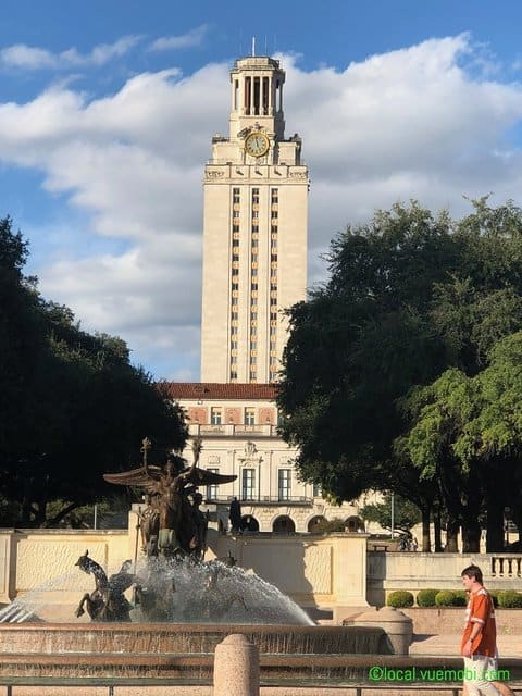 typical student day on campus with UT Tower on background