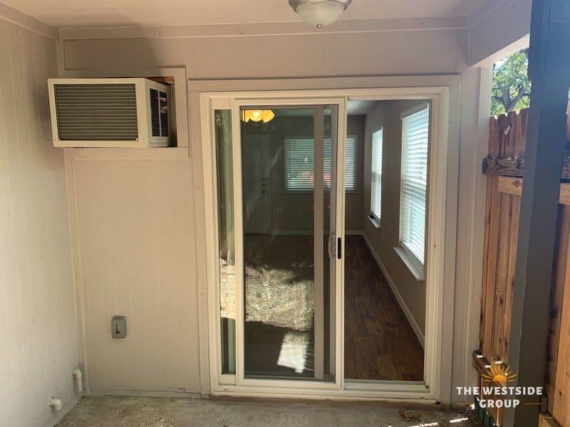 patio living space with sliding glass door on clarksville studios