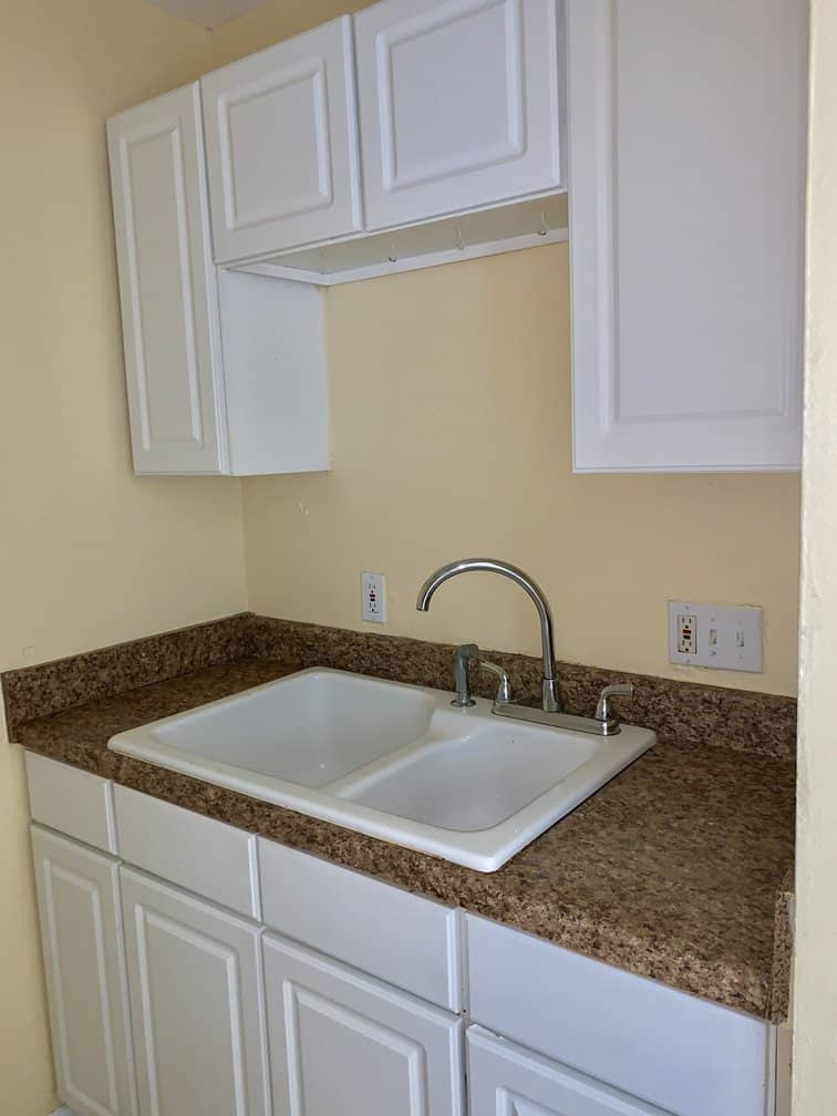 spacious kitchen cabinets and large sink